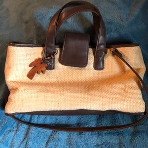 Liz Claiborne straw purse w/leather trim/straps.
